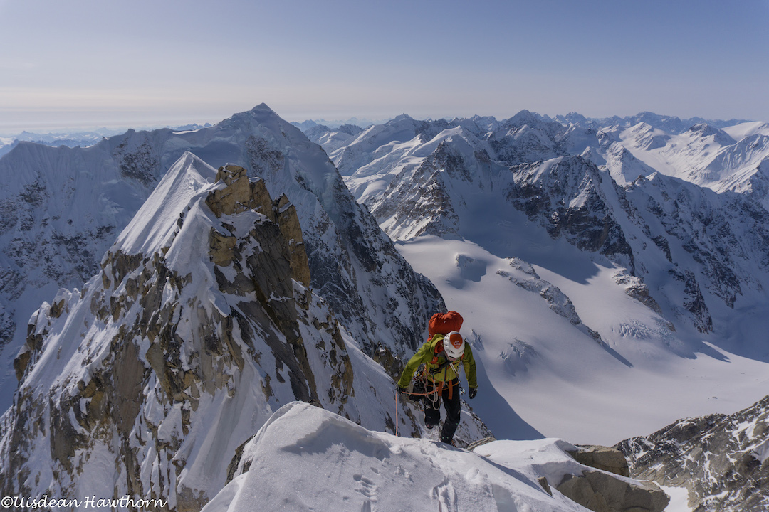Tom Livingstone coming up the summit ridge of Jezebel's east summit (9,450') after making the first ascent of Fun or Fear (1,200m, M6+ AI6 R 90˚) on the east face.