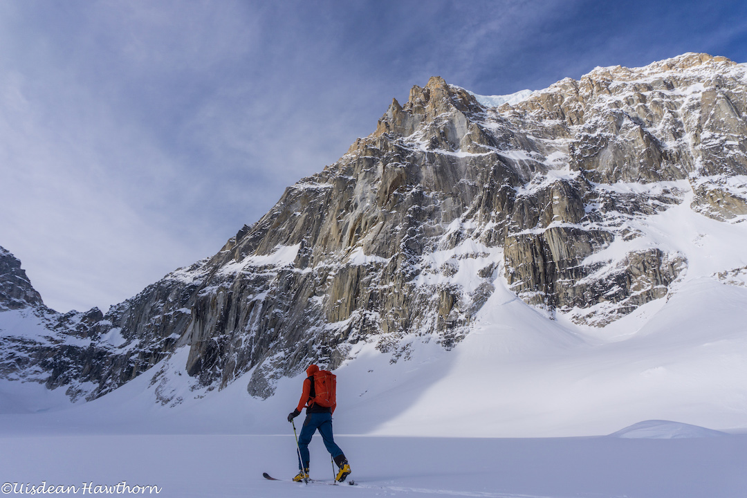 Tom Livingstone skiing beneath the east face of Jezebel (9,620') during a recon of the face.