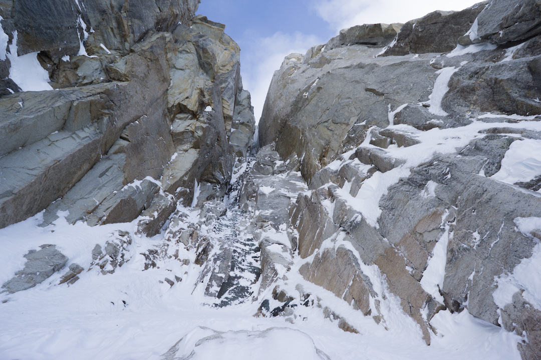 Looking up from Uisdean Hawthorn and Tom Livingstone's high point on the unclimbed north face of Jezebel (9,620'). This large slot chimney was pouring with spindrift, looked devoid of cracks and reliable protection, and featured strange compact yet chossy rock.