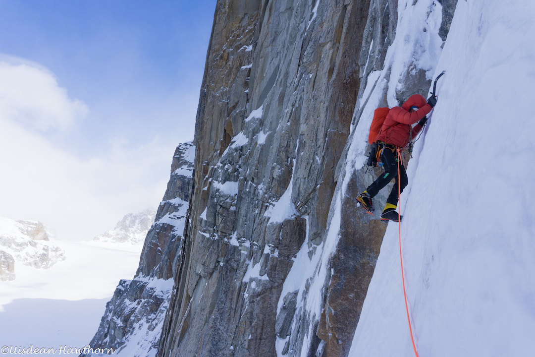 Tom Livingstone climbing steep, difficult-to-protect névé during his and Uisdean Hawthorn's attempt on the unclimbed north face of Jezebel (9,620') in the Revelation Mountains.