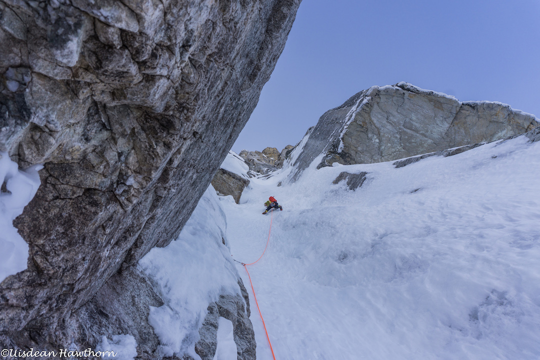 Tom Livingstone leading up steep, difficult-to-protect névé during his and Uisdean Hawthorn's attempt on the unclimbed north face of Jezebel (9,620') in the Revelation Mountains.