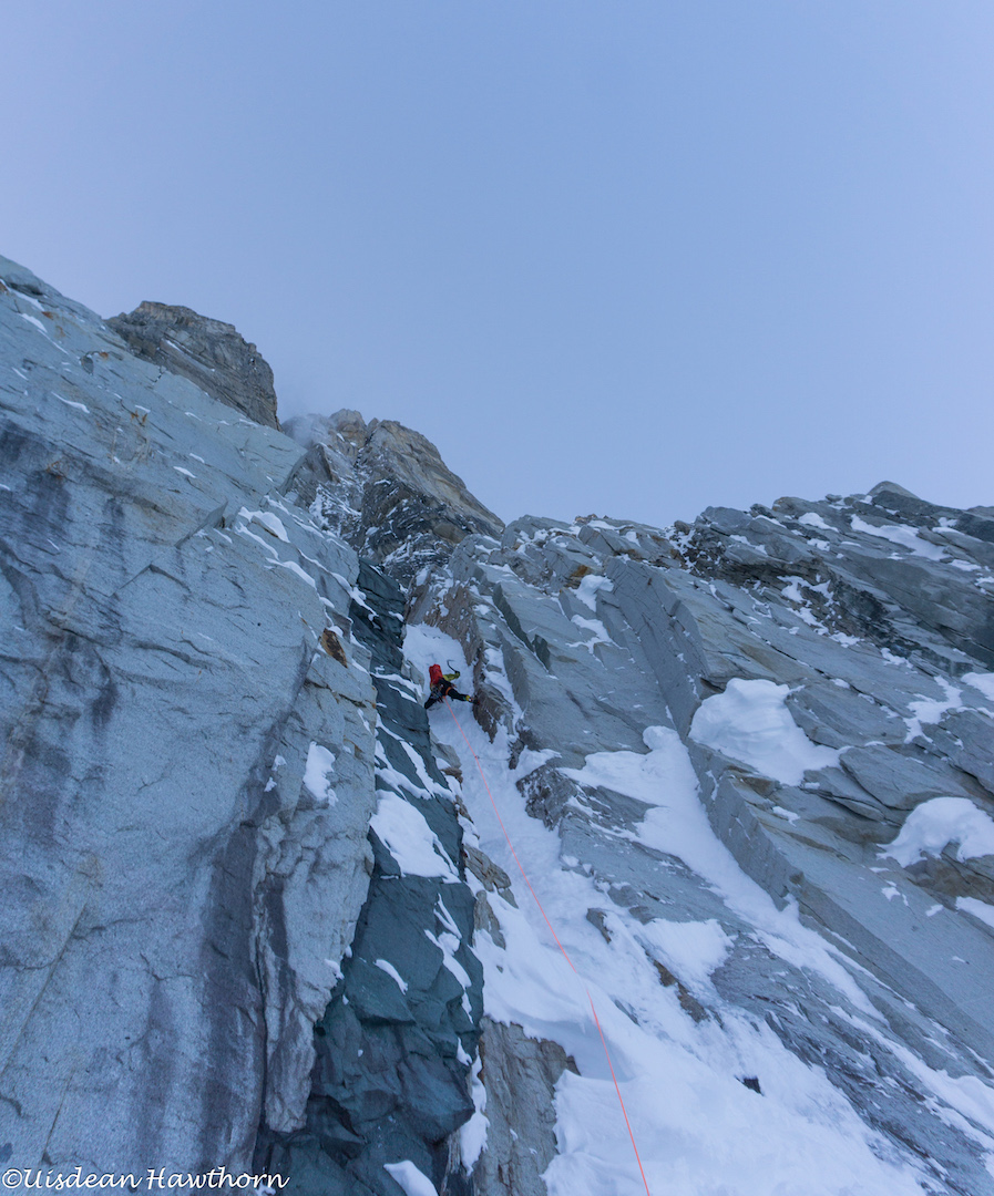 Tom Livingstone leading the first pitch during his and Uisdean Hawthorn's attempt on the unclimbed north face of Jezebel (9,620') in the Revelation Mountains.