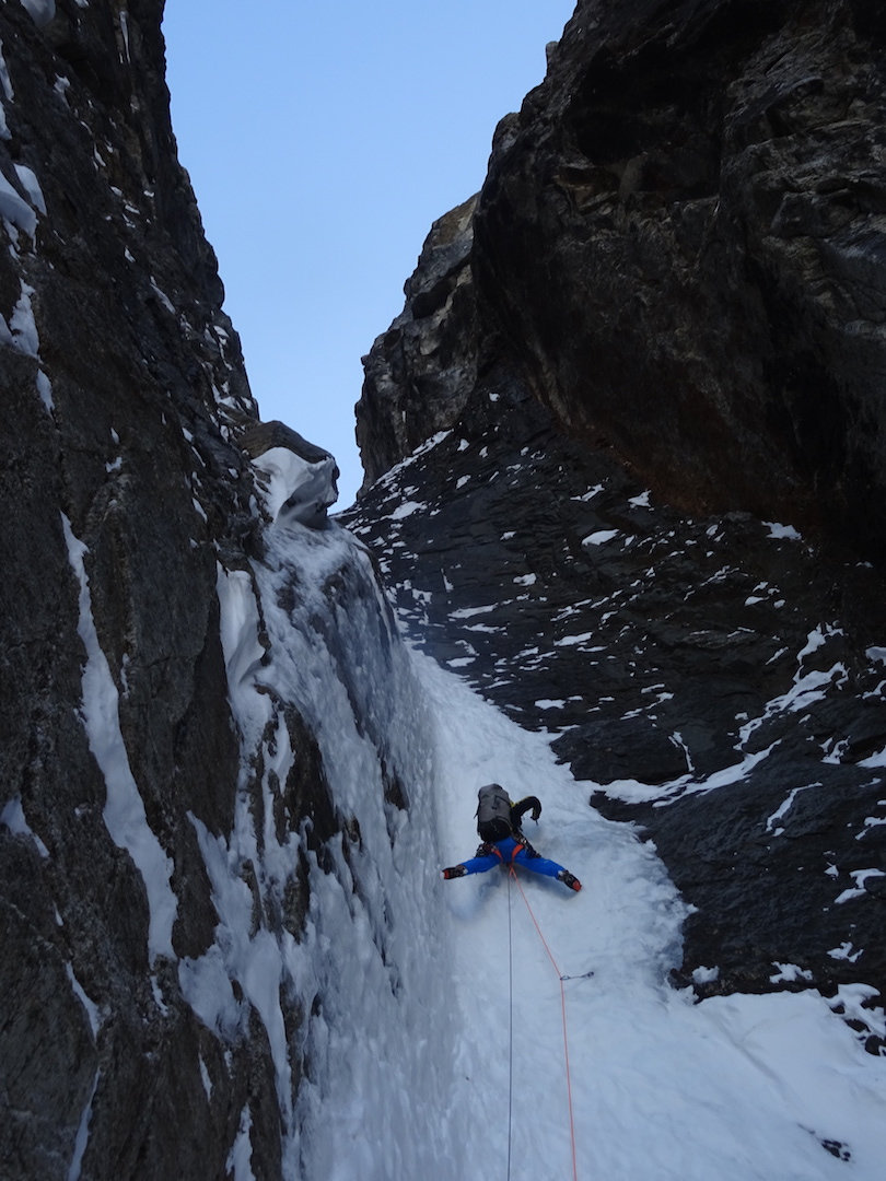 Steep, aesthetic névé climbing during the French attempt on a direct, unclimbed line on the west face of an unclimbed peak just north of Apocalypse. They were stopped just short of the ridge by a massive roof that would require aid climbing or detouring off the line to easier terrain, and they chose to descend from that high point.