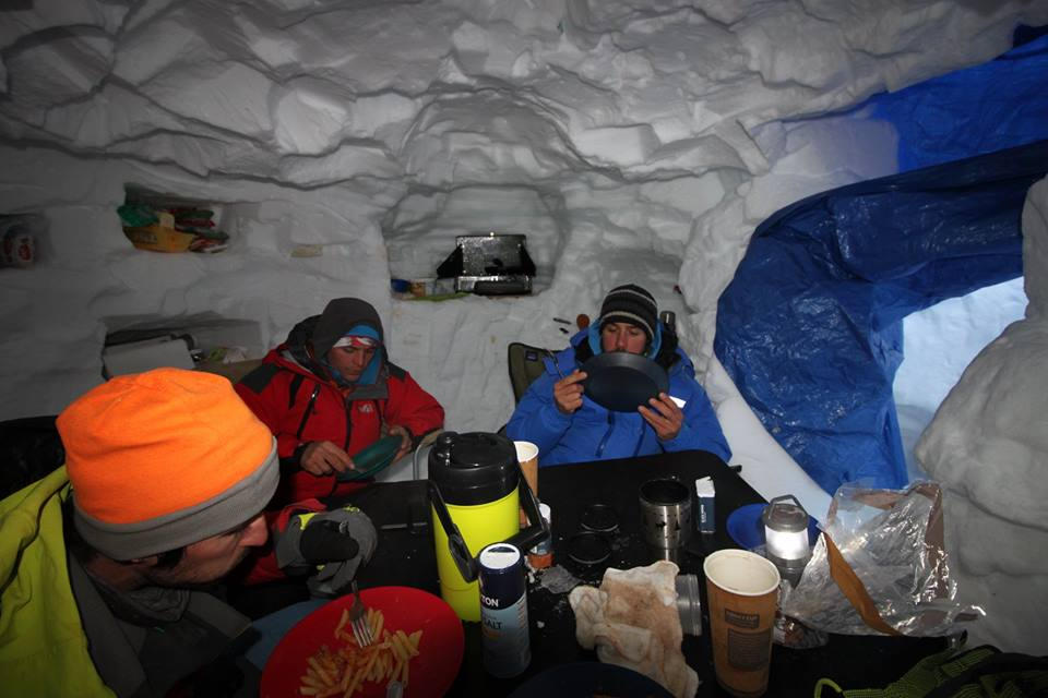 Base camp life inside the group's cozy snow cave. The Revelations are known for their fierce winds and long-lasting storms—several groups have had burly expedition tents destroyed by weather.