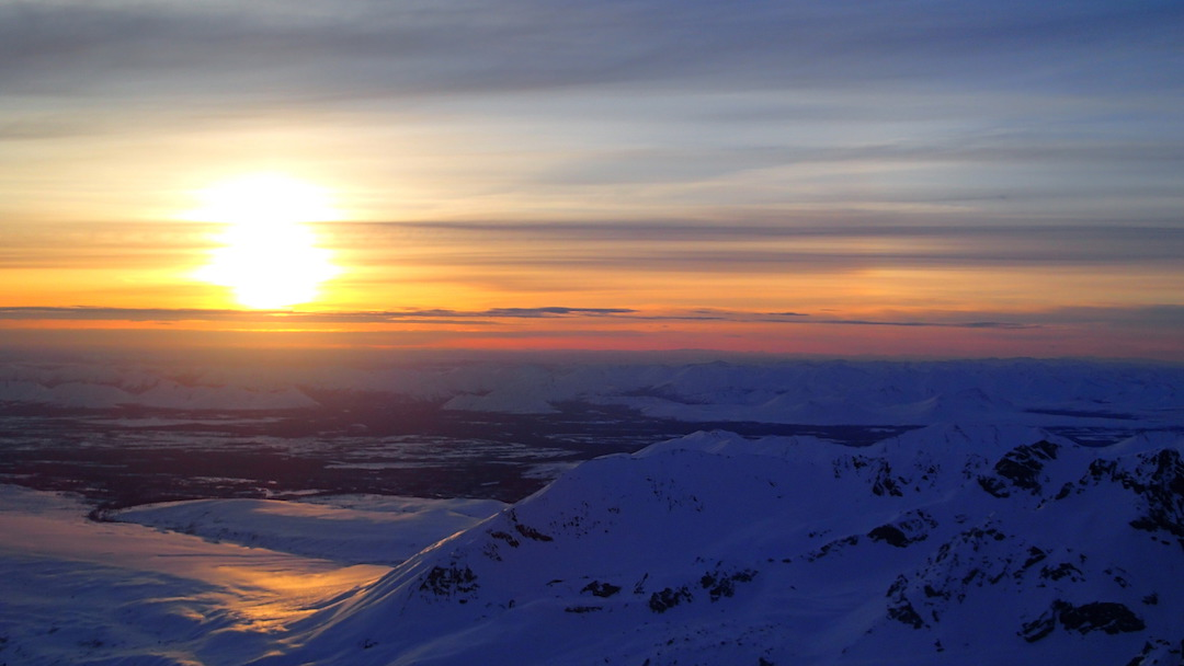 Sunrise over the endless Alaskan wilderness from the summit of Hydra after making the first ascent of Fa Pa Caou Per Aqui (600m, ED M8) on the northeast face.
