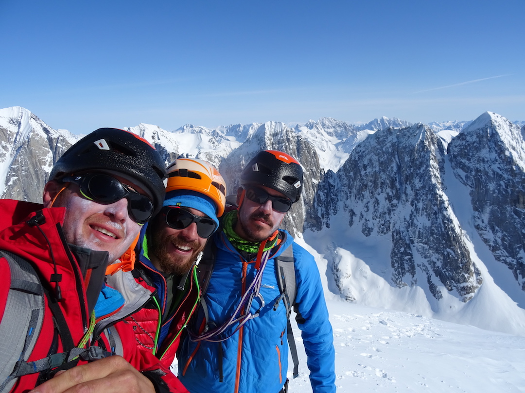 Thomas Auvaro, Jeremy Fino, and Antoine Rolle on the summit of Seraph after making the first ascent of MaKeMaLo (600m, ED- M7) on the mountain's northeast face.