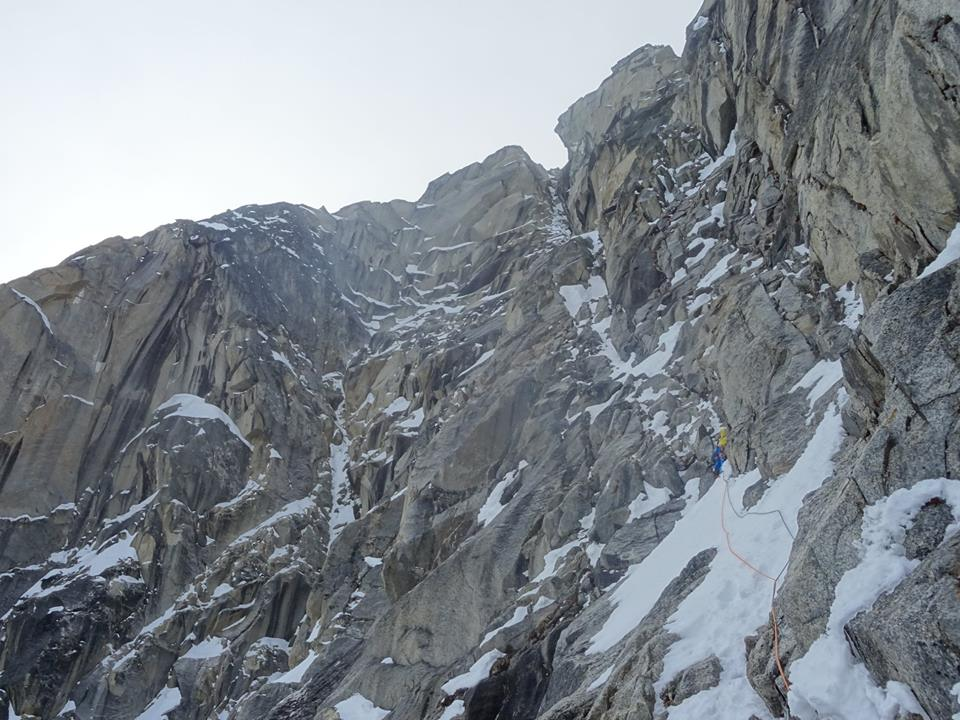 Climbing along the technical mixed ramp that defined the first ascent of Fa Pa Caou Per Aqui (600m, M8) on Hydra.
