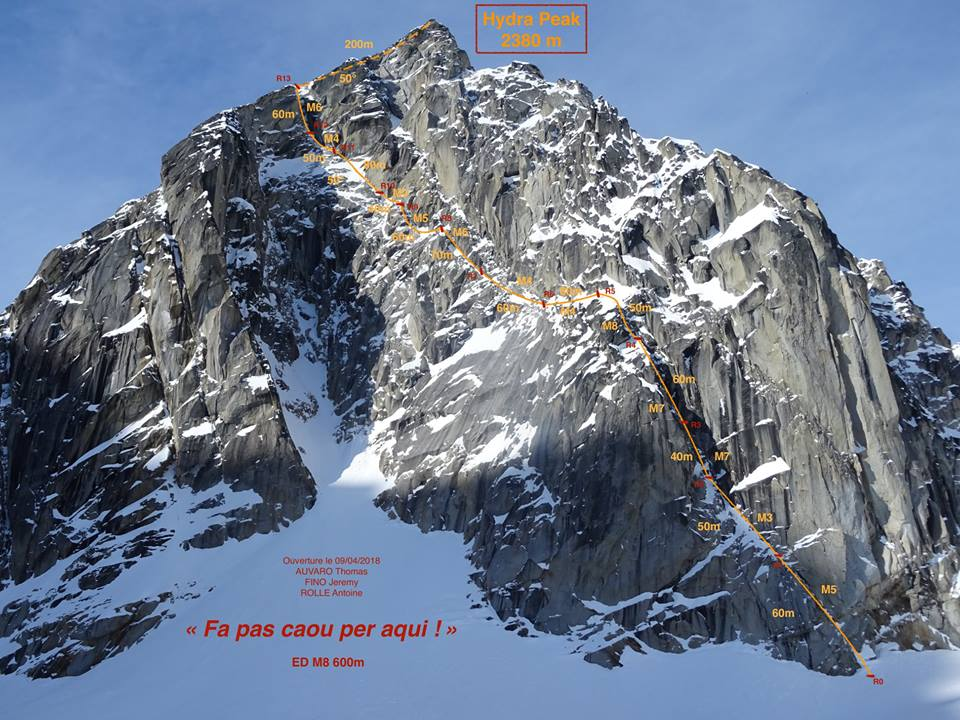 The northeast face of Hydra in Alaska's Revelation Mountains, showing the line of Fa Pa Caou Per Aqui (600m, M8). Thomas Auvaro, Jeremy Fino, and Antoine Rolle climbed this technical mixed ramp in a push, topping out at dawn. A 2014 route (Irwin-Vonk-Welsted) took the obvious gully system on the left, then moved right across a snowfield to the same exit as the French route.