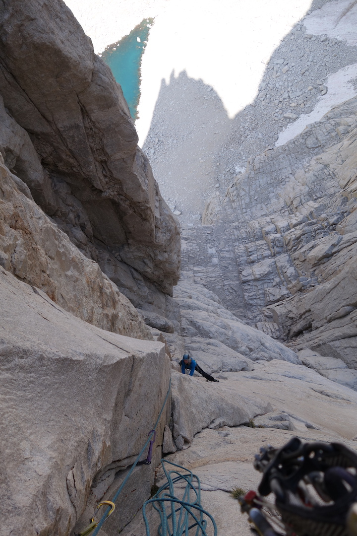 Patrick Longley following the sixth pitch of Until the Wheels Fall Off (1,100', IV 5.11 C1) on the west buttress of Mt. Chamberlin's northeast face in the Sierra Nevada.