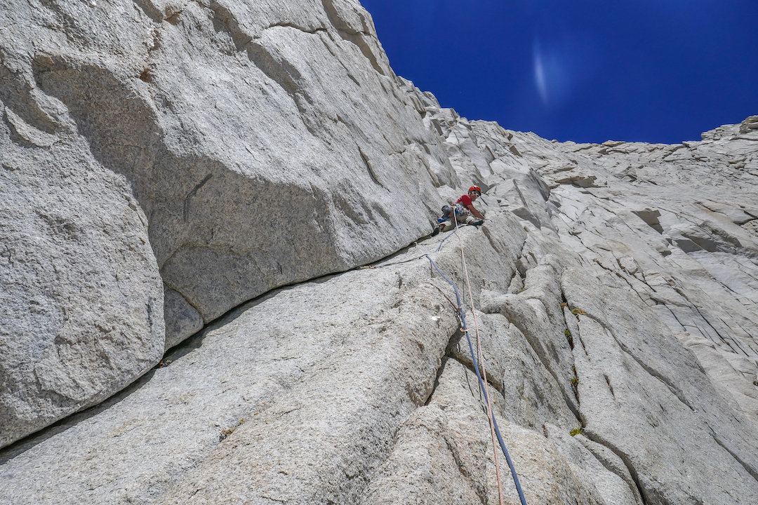 Shaun Reed leading a clean 10a corner during the first ascent of Dot the T's (III 5.11a) on the Cleaver (13,382').