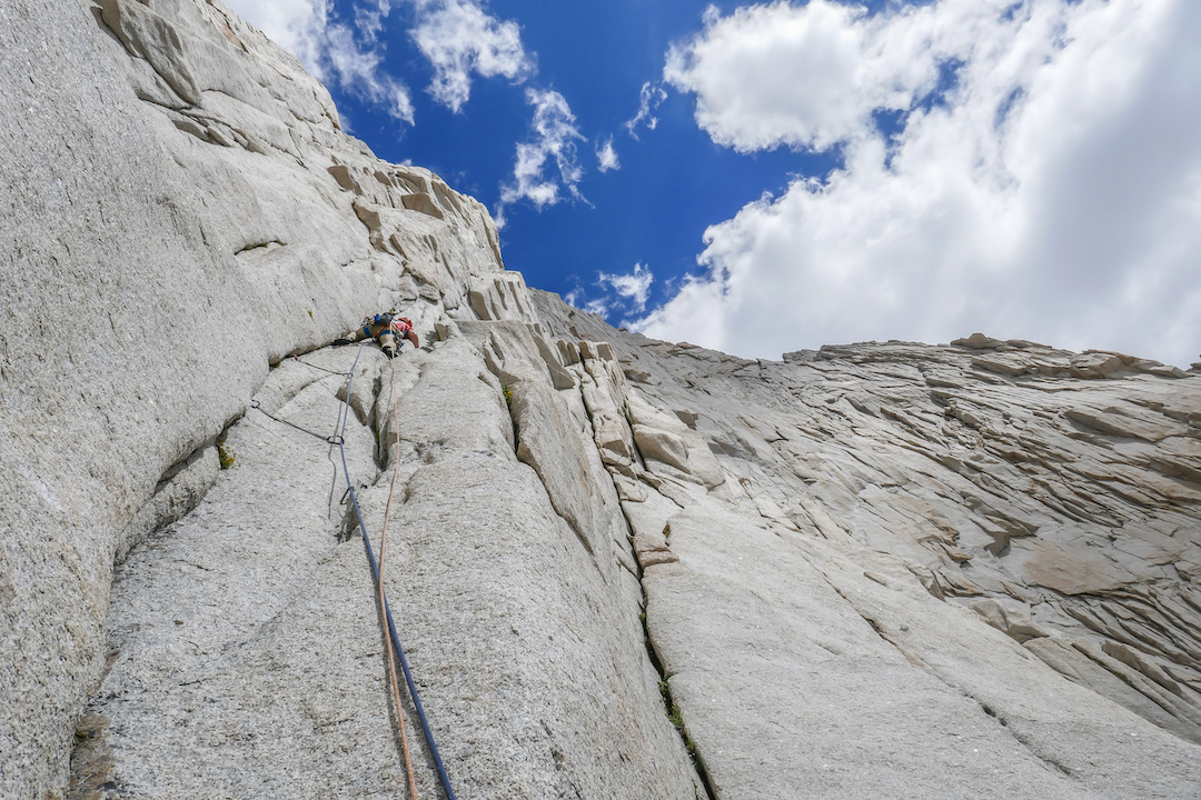 Shaun Reed starting up the first pitch of Dreamliner (III/IV 5.11c) during the first ascent. The prominent handcrack/corner system to his right is the start of Dot the T's (III 5.11a), which Reed and Musiyenko completed a month prior.