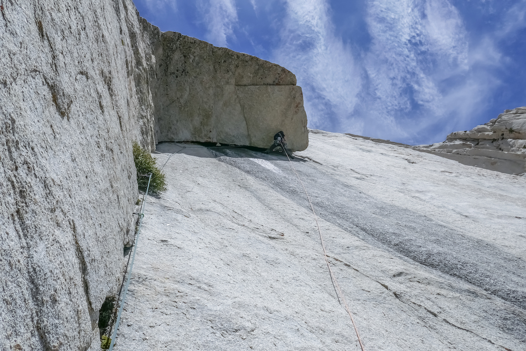Jeremy Ross laybacking out a giant roof partway up Pathways Through to Space (V 5.11a) on the south face of Lone Pine Peak during the first free ascent of the route.