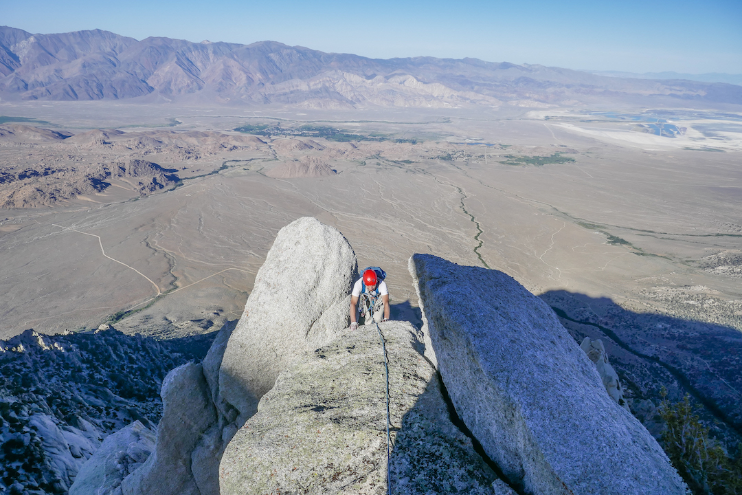 Chaz Langlier coming up to the summit of the Tomahawk Arete on Lone Pine Peak during the first ascent of the Arrowhead (ca 2,000', IV/V 5.11b/c). The town of Lone Pine is in the background below.