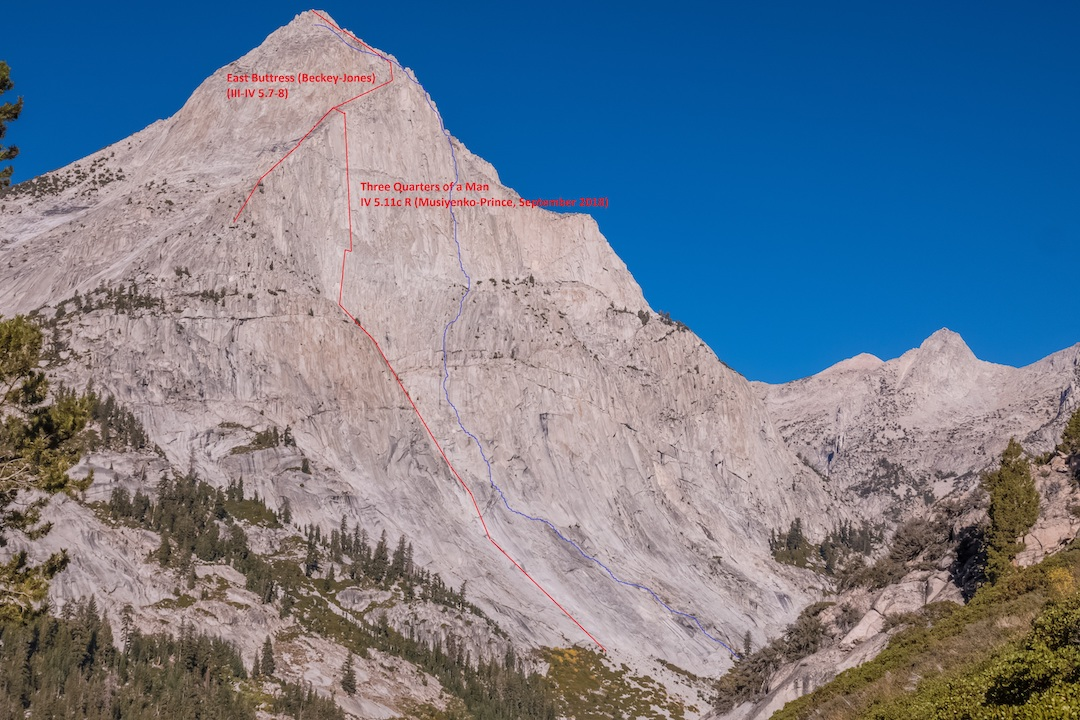 The southeast face of Langille Peak showing Three Quarters of a Man (IV 5.11c, Musiyenko-Prince) in red. The blue line, climbed by Jamie Ervin and Damien Nicodemi  in September, is likely the actual line of the East Buttress Direct (IV 5.10b, Rowell-Wilson, see AAJ 1989). Both routes eventually climb into the East Buttress (Beckey-Jones, 1970) to the southeastern summit, the obvious peak in the photo. The true summit of Langille is out view.