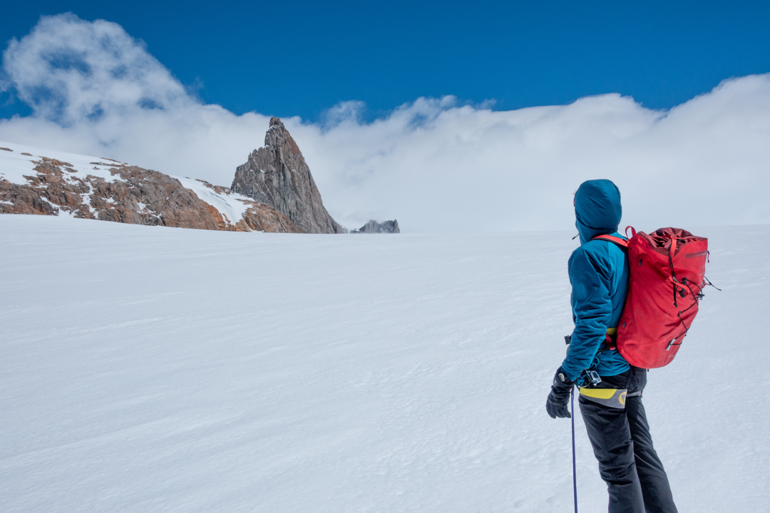 As seen from the Nef Glacier, Cerro Mangiafuocoa is the previously unnamed rock spire located halfway between Punta Pantagruel and Cerro Cachet. The east ridge route climbed the left skyline.