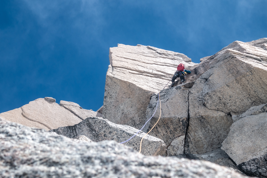 Luca Schiera leading the final pitch of L'appel du Vide (400m, 6c M4) on the east ridge of Cerro Mangiafuoco.