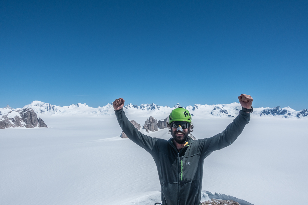 Paolo Marazzi on the summit of Cerro Mangiafuoco with a view to the south and west. Cerro Arenales is the snowy peak in the back left, Cerro Alfil is above Marazzi's helmet, Cerro De Geer is next to his left fist, and Cerro Margarita is the final, snowy peak visible on the right. A comprehensive, annotated panoramic photo looking in this direction (taken from the summit of Pantagruel) can be seen here: http://publications.americanalpineclub.org/articles/13201214737/Northern-Patagonian-Icefield-Punta-Pantagruel-and-Cerro-Fantasma.