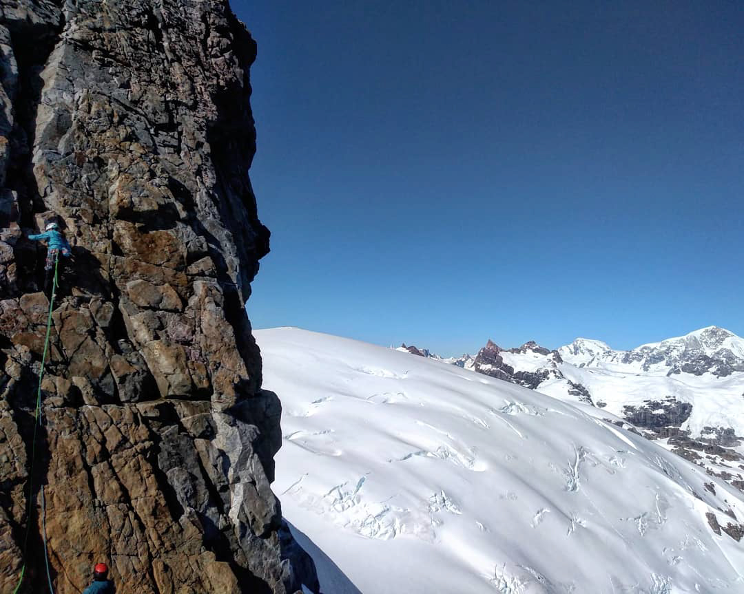 Jenifer Reyes leading on the north ridge of Cerro Caballo.