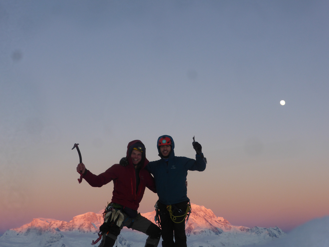 Ross Balharry and Javier Galleani Calderón on the summit of Cerro Chueco at sunrise, with a view southwest to the northeast face of San Valentin.