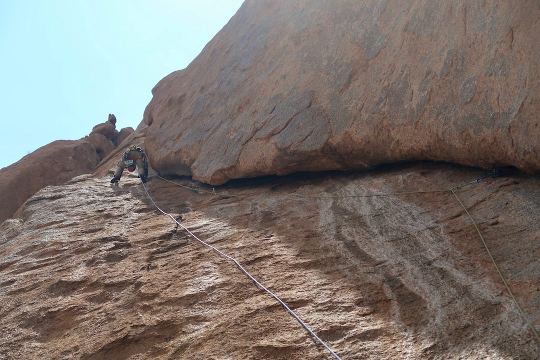 Hugh Thomas climbing the excellent wide crack on pitch two of Mrs. Balls.