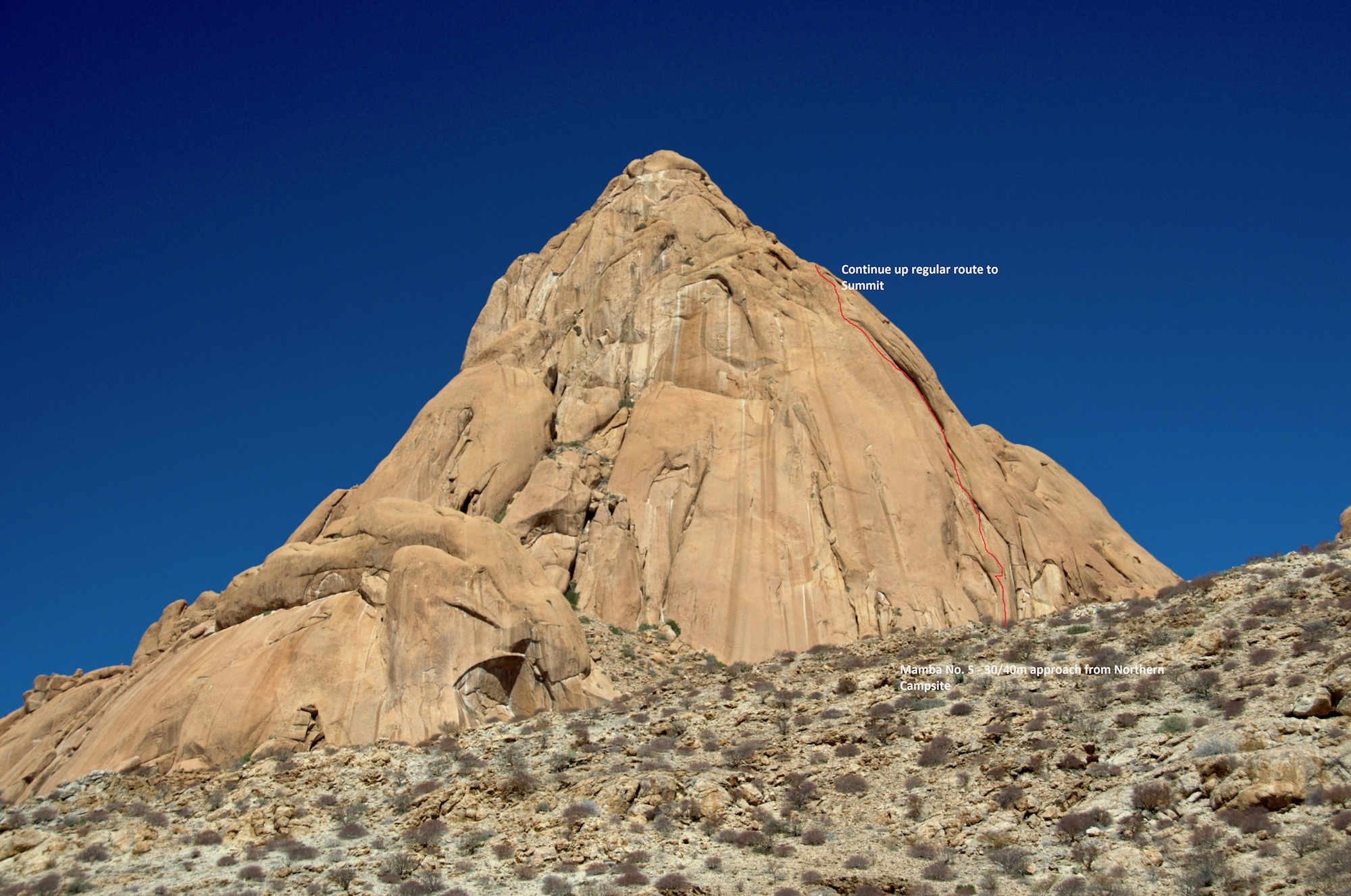 The nothwest face of Great Spitzkoppe, showing the line of Mamba No. 5. Another five pitches up the regular route gains the summit.