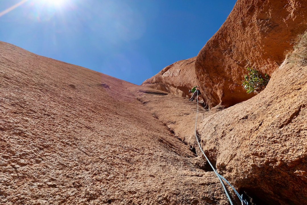 Traditional chimney climbing on the second groove pitch (pitch six) of Mamba No. 5.