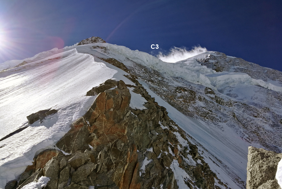 Looking up the north spur of Minya Konka, with Camp 3 (6,700m) marked. The summit is the dome-shaped top up to the right.