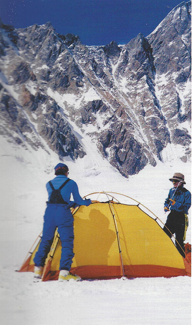 The 1998 Korean expedition's Camp 3 at 5,300m on the upper plateau of the Hailiuogou Glacier. The Korean expedition climbed to the broad col on the northeast ridge directly above the tent via difficult ice and mixed terrain.  Supplied by Kim Dongsoo