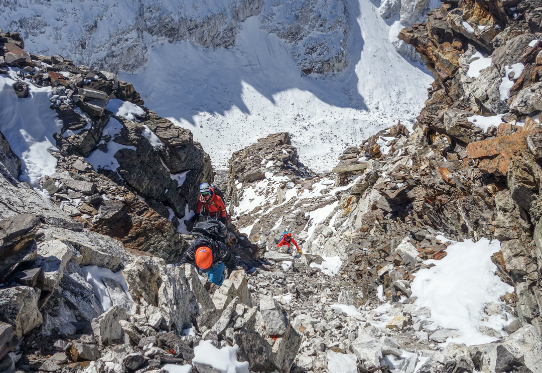 Climbing rotten rock near the top of the south face of Phasang during the first ascent.