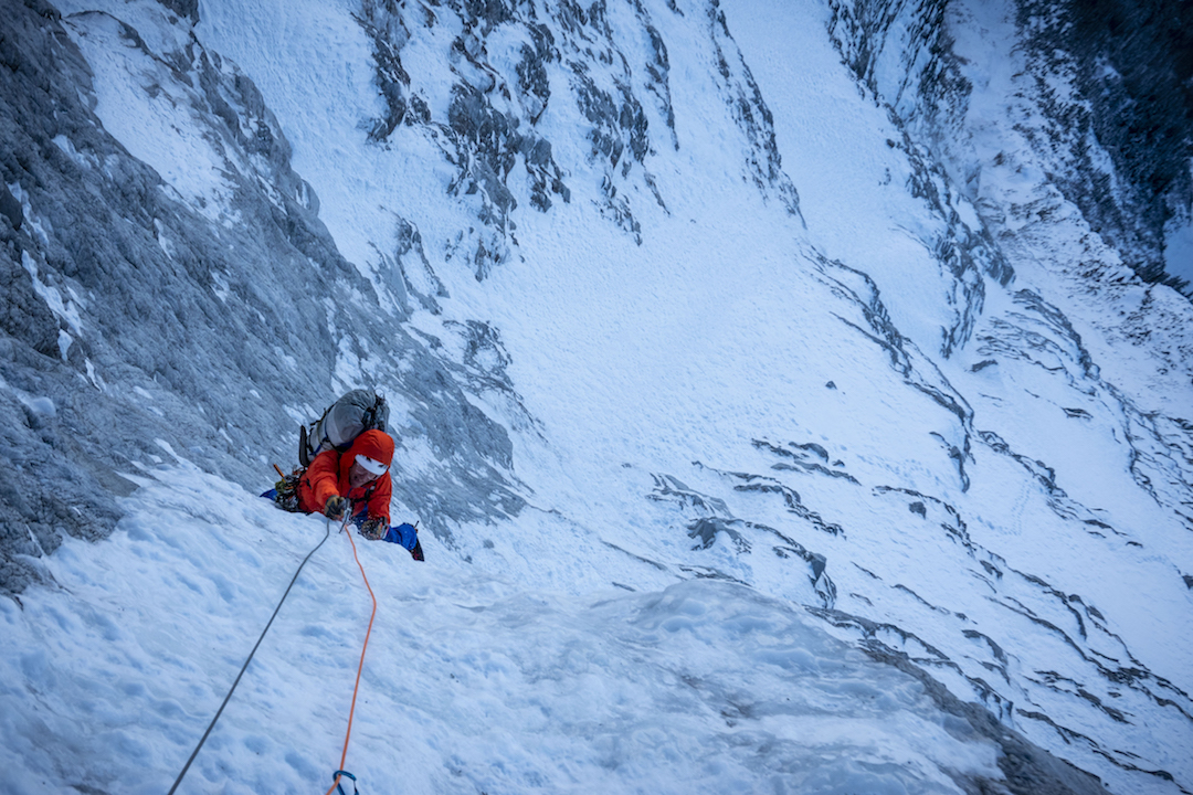 Chris Wright following the first pitch on the central ice hose early on the second day of climbing on Mt. Macdonald.