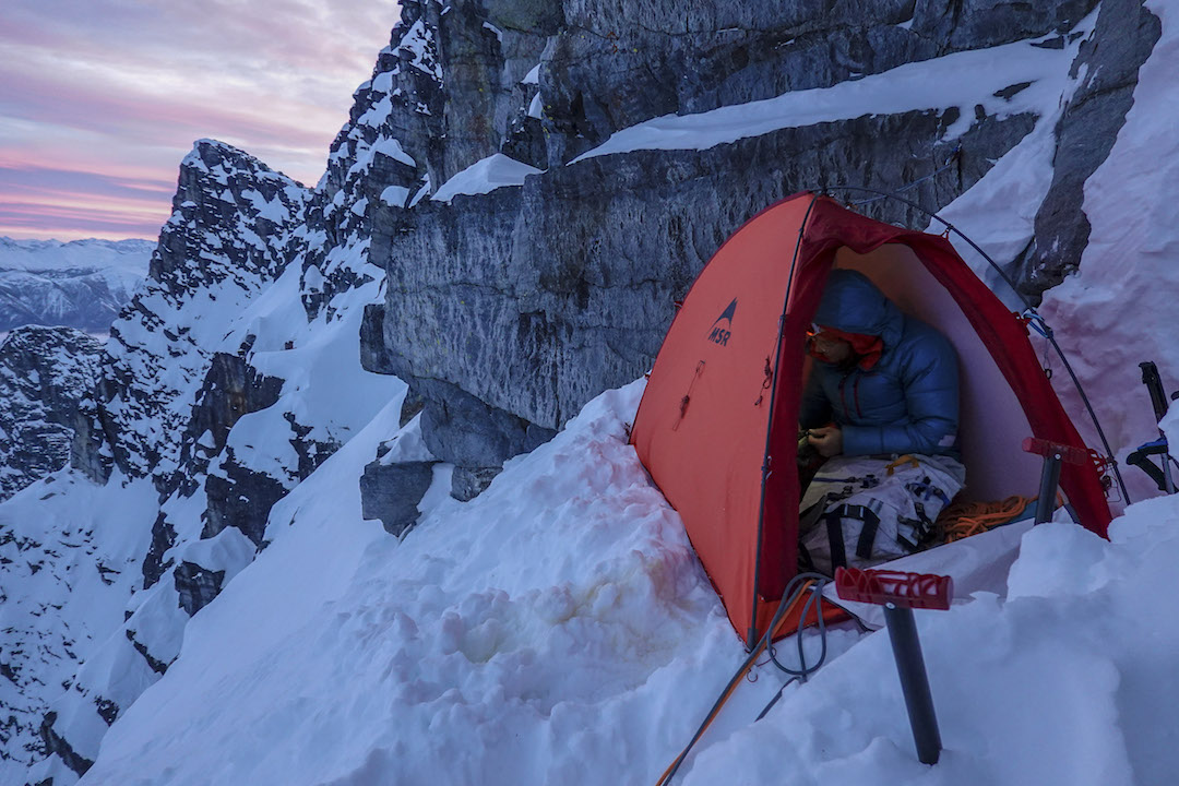 Chris Wright packs up under a gorgeous sunrise on the team's third day on Mt. Macdonald.