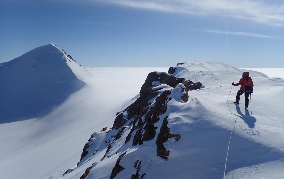 On the east ridge of Nujaq with Angilaaq behind.