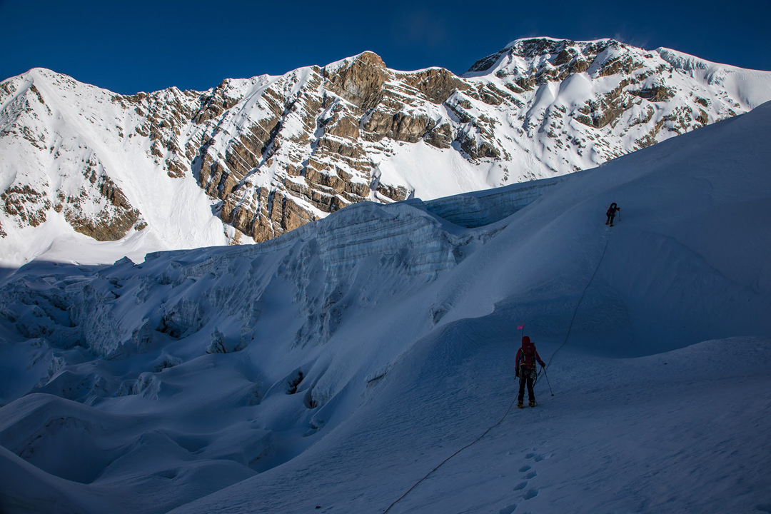 Working up the unnamed glacier southeast of Pankar Himal (6,264m). The long south ridge forms most of the skyline, with the summit directly above the climbers. The Japanese route (2018) finished up the northeast ridge, the skyline running to the right from the summit.