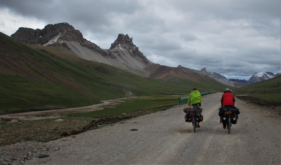 To reach unexplored mountains northwest of Yushu, three climbers rode four days to reach a camp at 4,800 meters, west of the town of Zhidoi. Here they cached their bikes and headed into the hills.