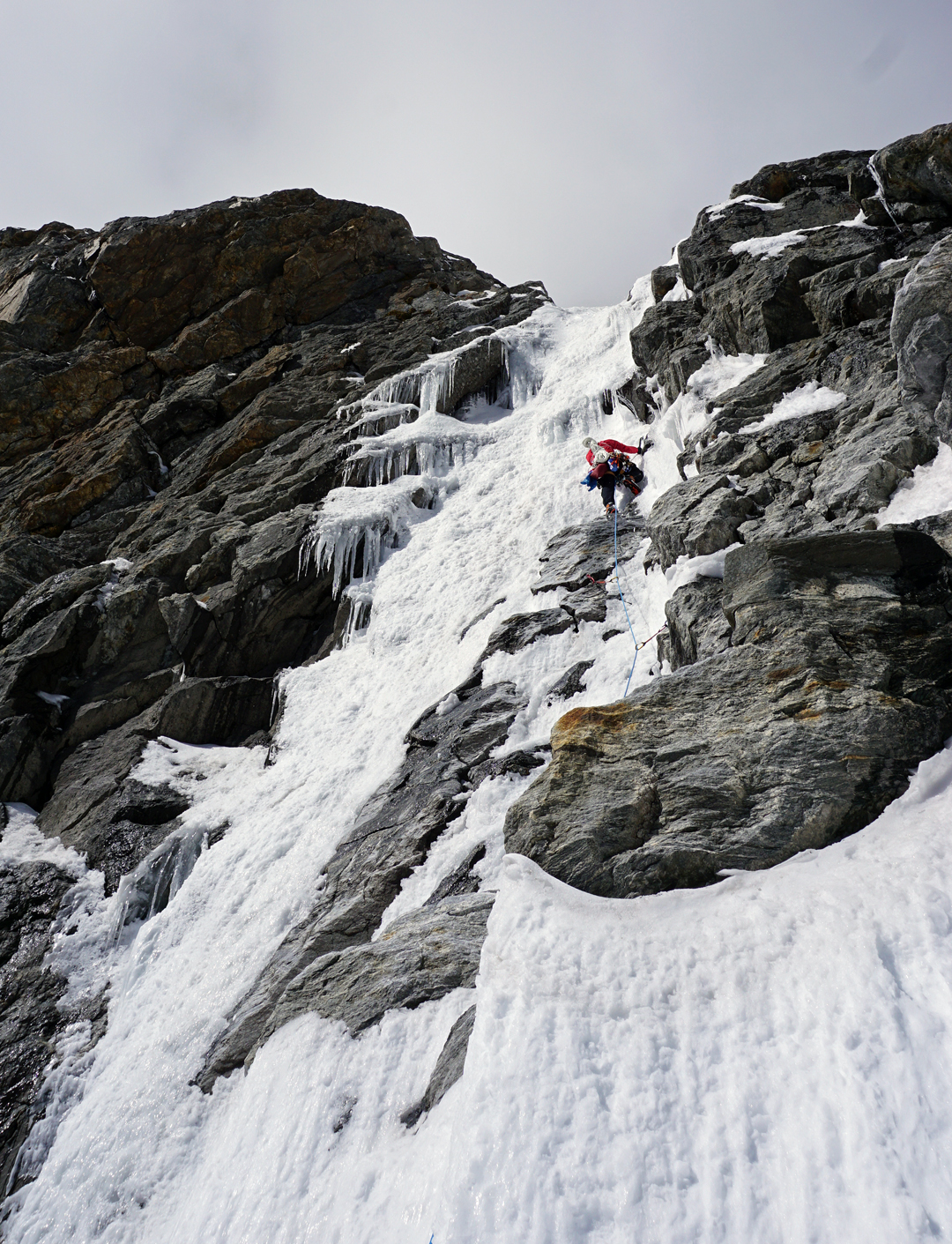 Yusuke Sato on an icefall during day one of Aal Izz Well on the northeast face of Cerro Kishtwar.