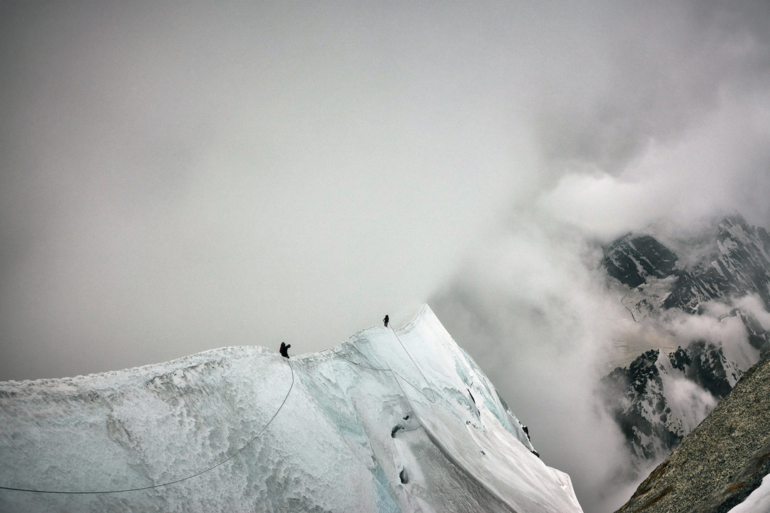 Malcolm Bass and Paul Figg on the south-southwest ridge of Janhukot in worsening weather during day three of the first ascent.