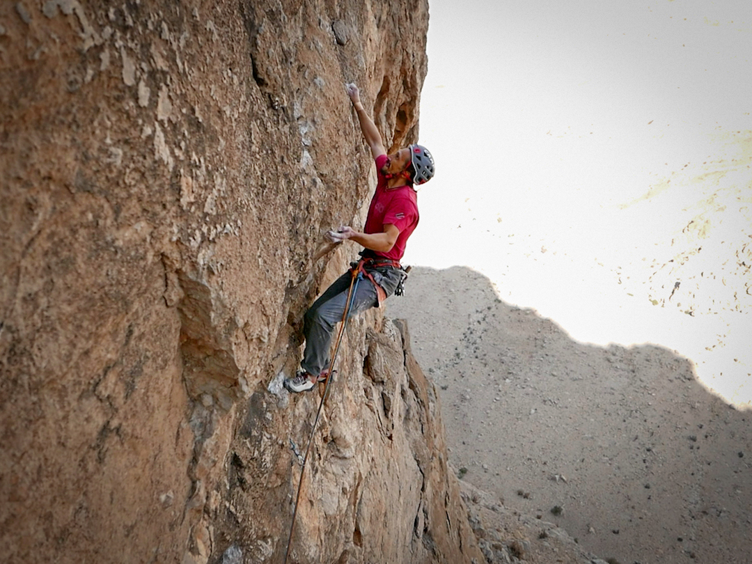 Simone Pedeferri attempting to redpoint the crux pitch (8a) of Vacanze (R)omane on Jebel Kawr.