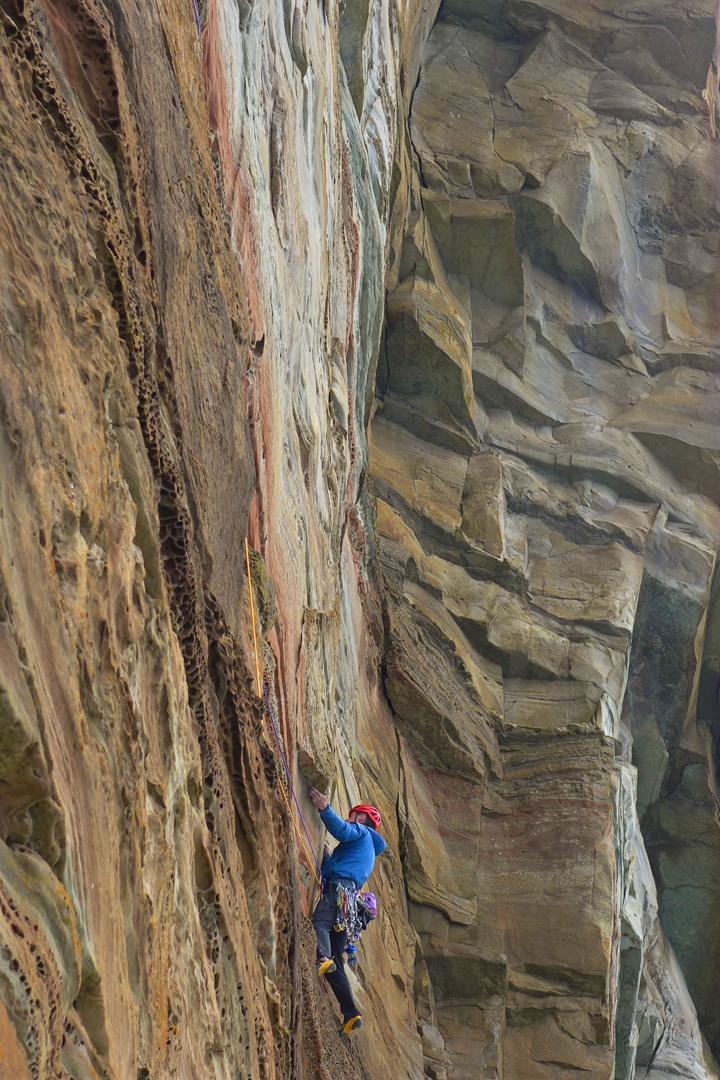 Pitch two (5c). Dave Macleod traversing to the large corner in the lower half of Ultima Thule, Nebbifjeld.