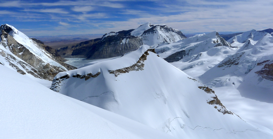 Rongla Kangri (6,647m, center far back) and Rongla's southern top (Kanti East) in front of it. Peak 6,275m is at right and Churau far right. Kojichuwa South (6,264m) in foreground.