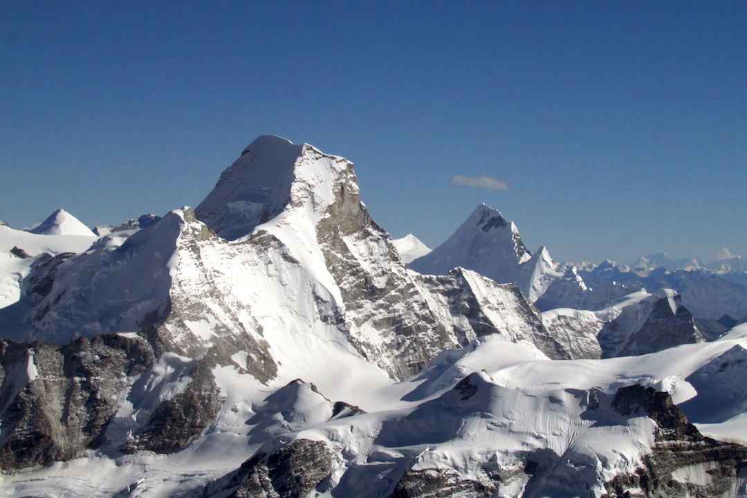 Seen from Peak 6,419m: Kaqur Kangri (6,859m) is the high peak in center; Myung Thang Kang (6,449m, unclimbed and on the permit list) is left and in front of Kaqur; and Lalung is right of center.