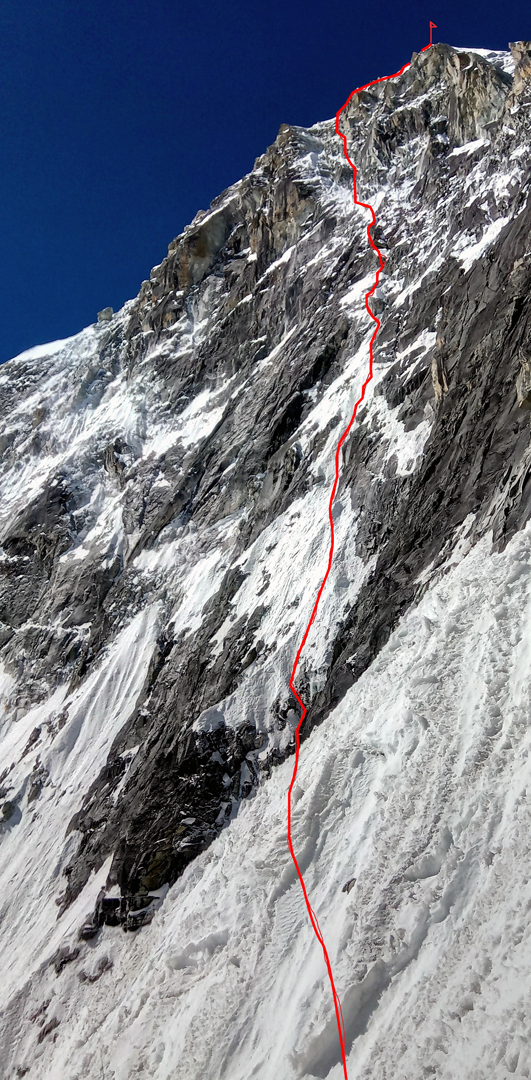 Seen from the north ridge, the steep upper northeast face of Kyajo Ri showing the line of Lapse of Reason.
