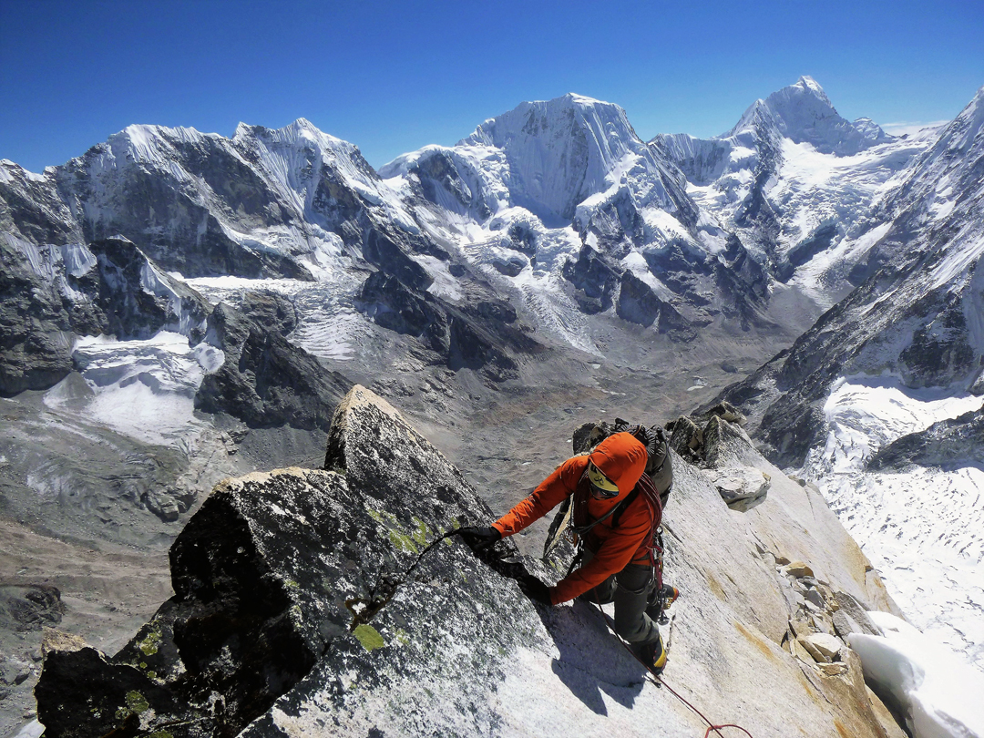 Jesus Ibarz on the start of the upper southeast ridge of Langdung during the ascent of the route Bihana. In the background, directly above his head, is Rolwaling Kang (6,664m), while the higher summit to its right is Takargo (6,771m). The skyline to the left leads toward Drangnag Ri (summit off picture).