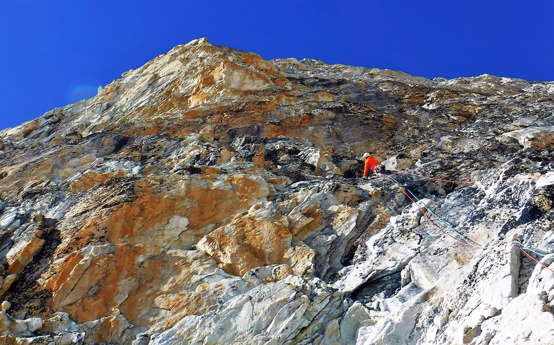 Jesus Ibarz in a sea of granite on the lower buttress of the southeast ridge of Langdung.