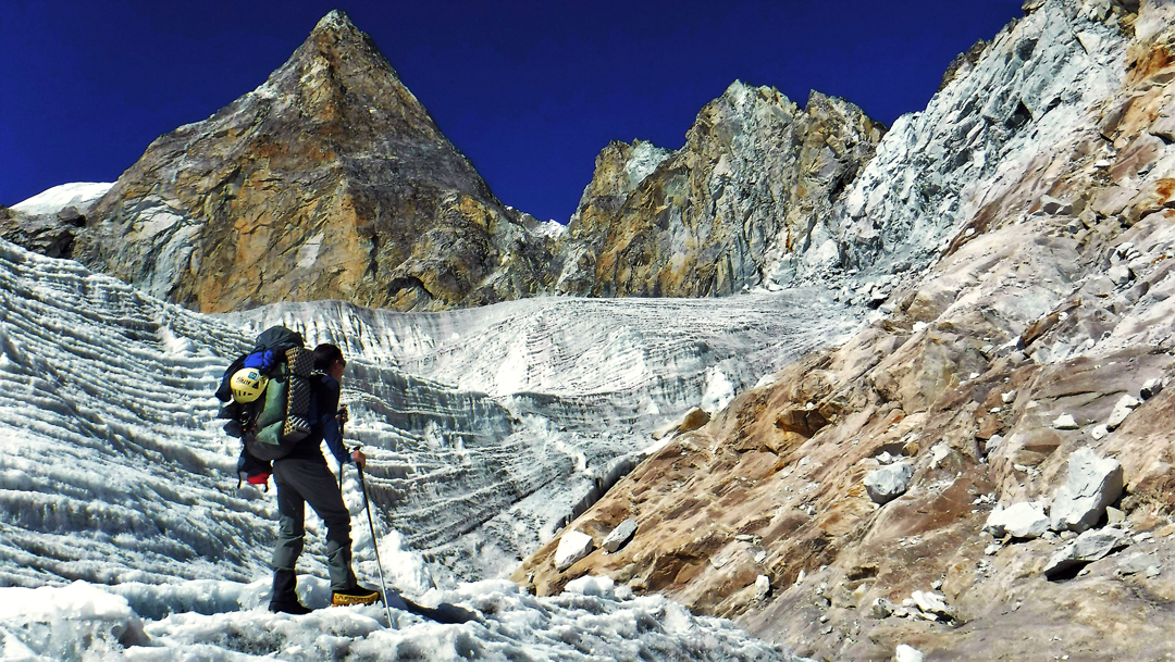 Approaching the triangular rock buttress that forms the base of the southeast ridge of Langdung.