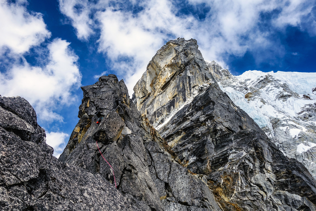 Climbing toward the top of the detached rock tower and bivouac site on the southwest pillar of Lobuche East. Behind is the prow climbed in 1991 by Eric Brand and Pemba Norbu Sherpa.