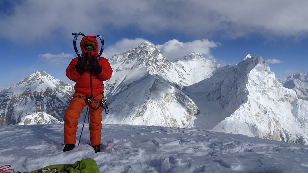 Zsolt Torok on the summit of Pumori with, to the left, Changtse, and to the right Everest, Lhotse, and Nuptse surrounding the Western Cwm.