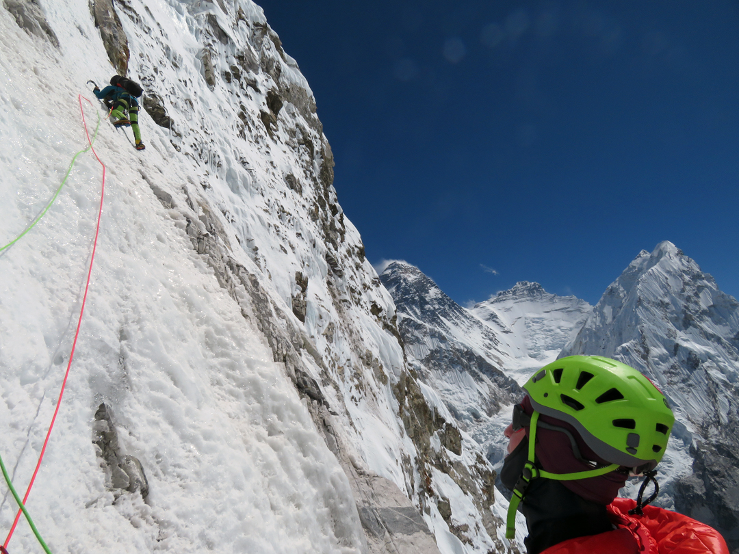 Zsolt Torok leading on day two on Pumori's southeast face, with Everest, Lhotse, and Nuptse in the background.