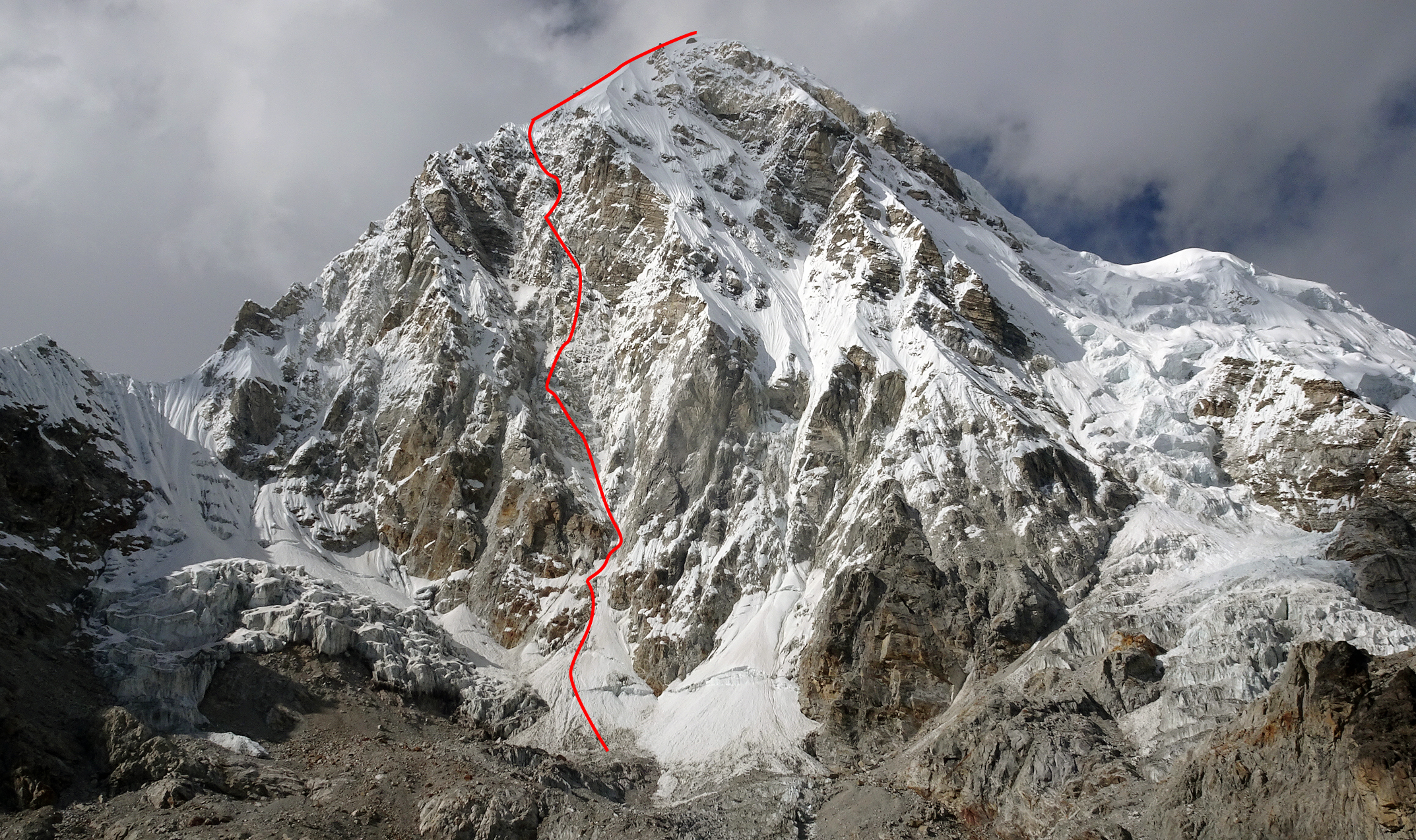 The southeast face of Pumori and the line of the 2018 Romanian route Le Voyage du Petit Prince. The 1986 Scottish Route and other lines up the face are all to the right of the big rock pillar. See photo in AAJ 2018.