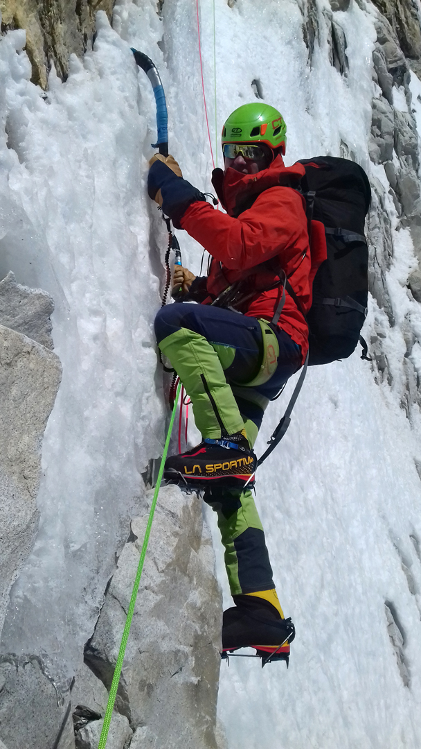 Zsolt Torok climbing steep ice during the first ascent of Le Voyage du Petit Prince, Pumori southeast face.