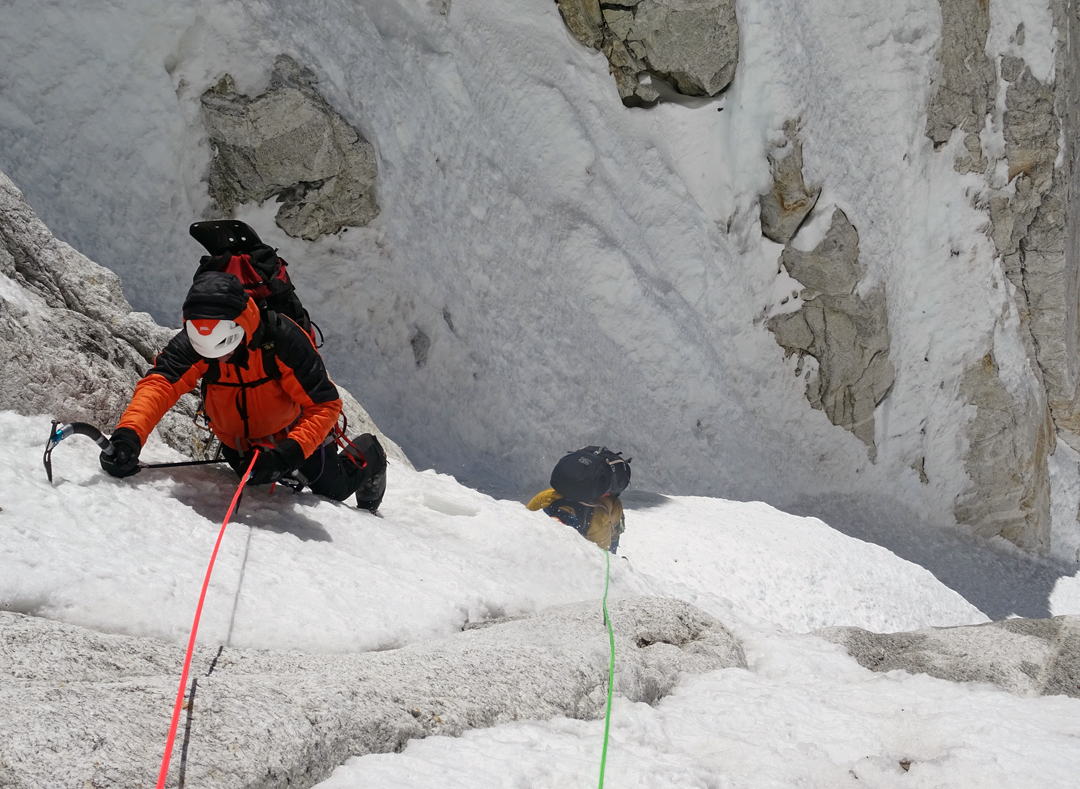 Romeo Popa followed by Zsolt Torok in snow/ice runnels during the 2018 ascent of the southeast face of Pumori.